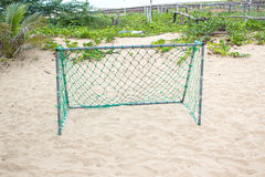 Green goal net on beach Royalty Free Stock Images