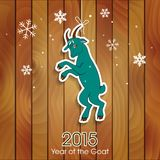 Green goat decoration on a wooden background Stock Image