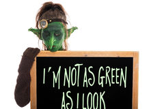 Green goblin with slate, englisch phrase Royalty Free Stock Photo