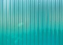 Green goffered metal texture, corrugated steel surface. Industrial background Royalty Free Stock Photography