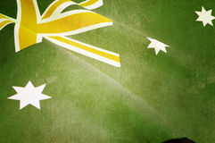 Green and gold australian flag. Retro grunge style background close up of Australian Southern Cross flag for national public holiday event in unofficial green stock image