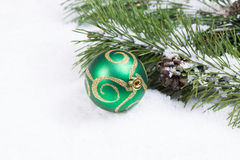 Green and Gold Christmas Ornament with Fir branch  Royalty Free Stock Photography