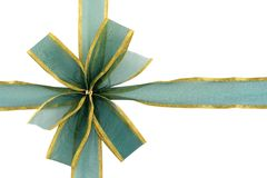 Green and Gold Gift Bow. A shiny gold-edged green ribbon bow, on white royalty free stock photography