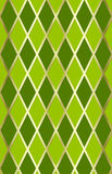 Green/gold harliquin. Pattern background royalty free stock photos