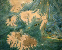 Green and gold marbling background Stock Photos