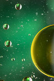 Green and gold oil and water abstract Stock Images