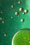 Green and gold oil and water abstract Royalty Free Stock Photo