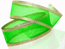 Green & Gold Ribbon. Green translucent mesh ribbon with gold foil trim.  Shot backlit on white with nice reflection. Not an isolation Stock Photography