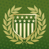 Green and Gold Shield on a Star Background. Green and Gold Shield with laurels on a Star Background Stock Photography