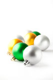 Green, gold and silver Christmas baubles on white Royalty Free Stock Photo