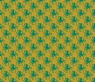 Green on gold simple octopus pattern seamless repeat background. Two colour simple octopus pattern seamless repeat background. Could be used for background Stock Photo