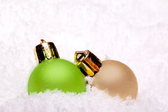 Green and golden christmas ball ornaments Royalty Free Stock Photography
