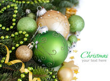 Green and golden Christmas ornaments border. Green and golden  Christmas ornaments border on white background Stock Photos