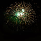 Green golden colorful amazing fireworks Stock Images