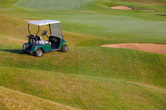 Green golf cart on the empty golf course Stock Photography