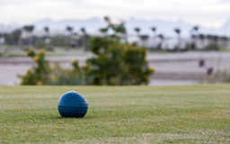 A green golf course. With a backdrop of palm trees and mountains Stock Photography