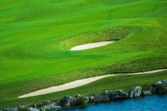 Green Golf Course Field. With Sandy Spots and the Pond. Golf Playing Theme Stock Image