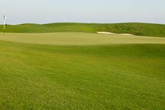 Green golf course field. With sky Royalty Free Stock Photo