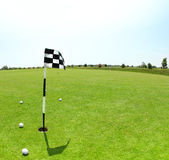 Green golf course with flag Royalty Free Stock Photos