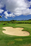 Green golf course panorama sand bunker with blue sky in summer Stock Photo