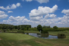 Green golf field and blue cloudy sky. Green golf field and blue  sky Stock Photo