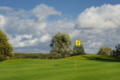 Green golf field and blue cloudy sky. european landscape Royalty Free Stock Photography