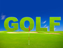 Green golf field with blue sky background Royalty Free Stock Image