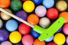 Green Golf Putter with Colorful Balls Stock Images