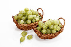 Green gooseberries in baskets Stock Images