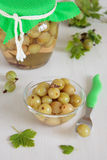 Green gooseberries, marinated with spices Stock Photos