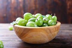 Green gooseberry in a plate stock photos