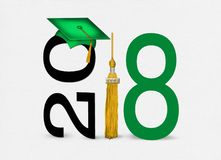 Green 2018 graduation cap with tassel. Gold tassel with green graduation hat for class of 2018 on soft textured white background Royalty Free Stock Images