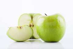 Green Granny Smith apple. On a white background with water drops Royalty Free Stock Photo