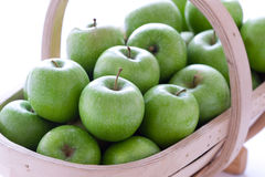 Green granny smith apples in a trug Royalty Free Stock Photography