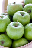Green granny smith apples in a wooden trug. Green granny smith apples in a trug close up Royalty Free Stock Photo