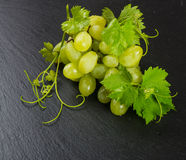 Green grape cluster on a slate  surface Royalty Free Stock Photography