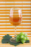 Green grape cluster and wine Royalty Free Stock Image