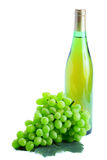 Green grape cluster and wine Royalty Free Stock Images