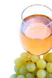 Green grape cluster and wine Stock Photography