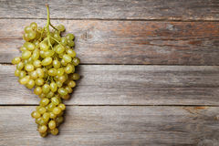 Green grape on the grey wooden background Royalty Free Stock Image
