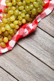 Green grape on the grey wooden background Royalty Free Stock Images