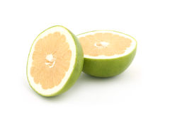 Green grapefruit. Grapefruit slices on white background royalty free stock photography