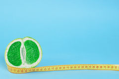 Green grapefruit with meter Royalty Free Stock Images