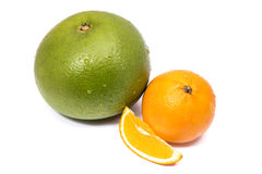 Green grapefruit and orange Stock Images