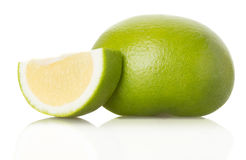 Green grapefruit and slices on white background Stock Photography