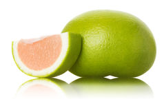 Green grapefruit and slices on white background Stock Images