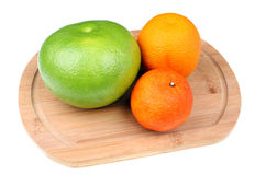 Green grapefruit sweetie, mandarin and orange Stock Photography