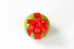 Green Grapefruit With Red Ribbon Royalty Free Stock Photo