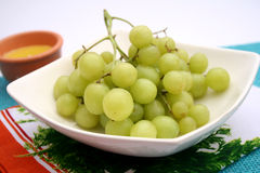 Green grapes. Some fresh green grapes in a bowl royalty free stock photos
