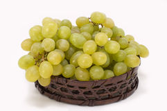 Green grapes. Green grapes in basket on a white background Stock Photography
